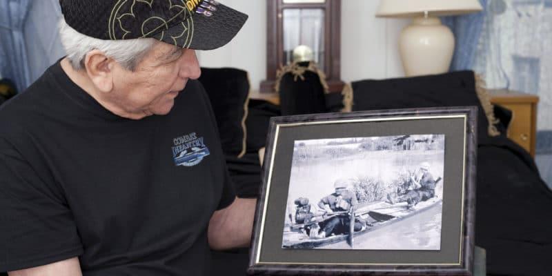 Vietnam War Veteran Looks At Old War Photo Of Himself